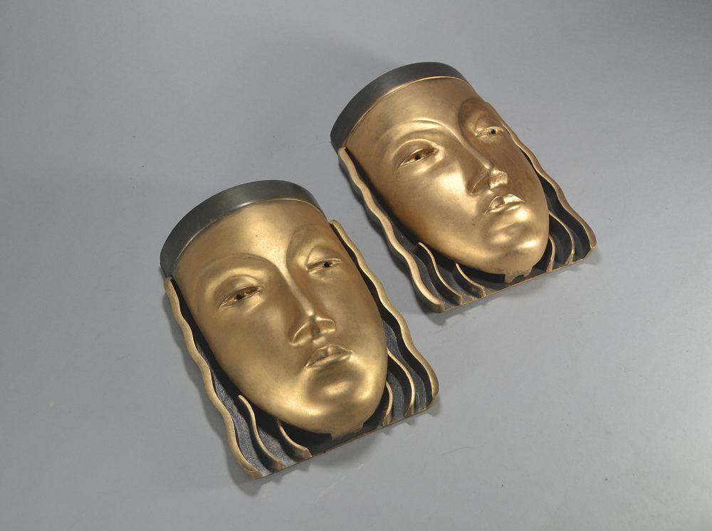 Pair of figural art deco bronze sconces lamp. Lady faces.