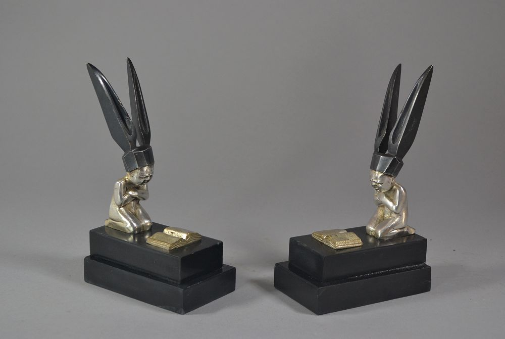 Bronze art deco bookends. BOURET. Dunce's cap. Mascots