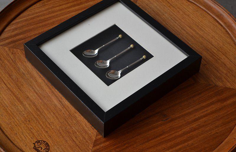 Framed sterling Ivory art deco spoons