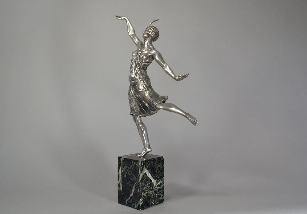 Joe Descomps tall bronze dancer with headdress