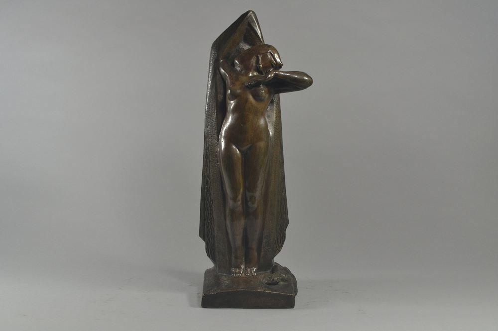 Bronze figure of an egyptian lady with snake. Csaky era.