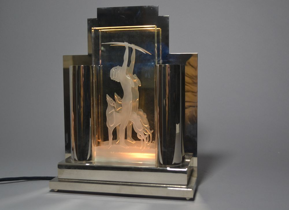 Art deco lamp. Nickel plated metal and glass plate