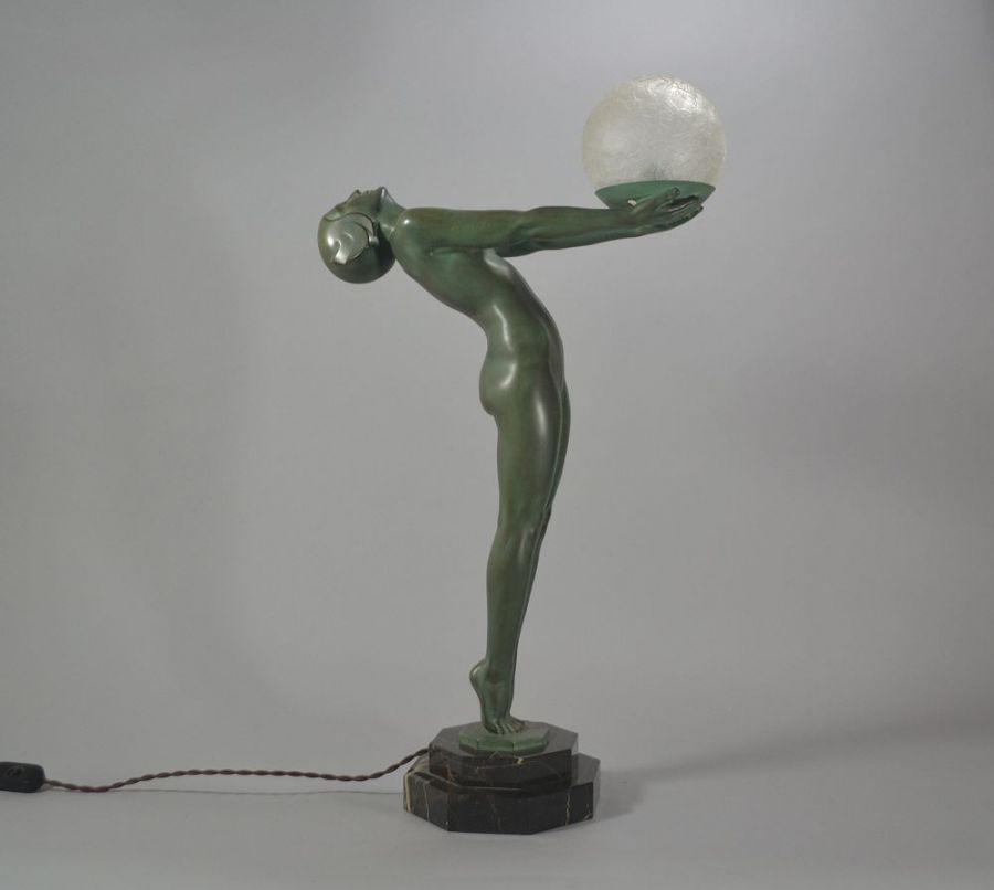 Iconic Max Le Verrier figural lamp.