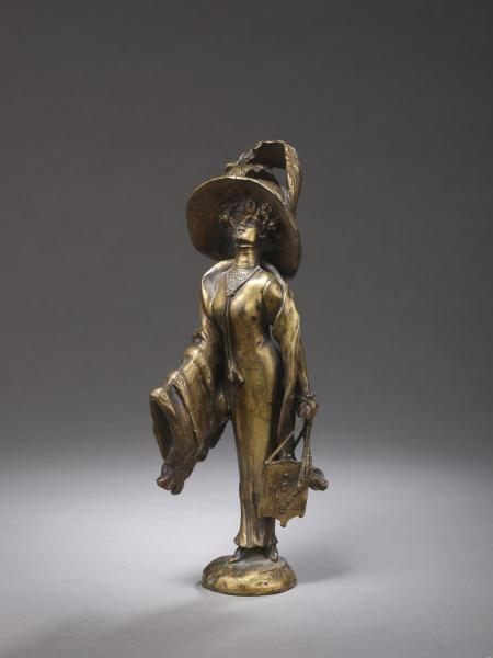 Georges Flamand. Bronze figure of elegant woman with hat