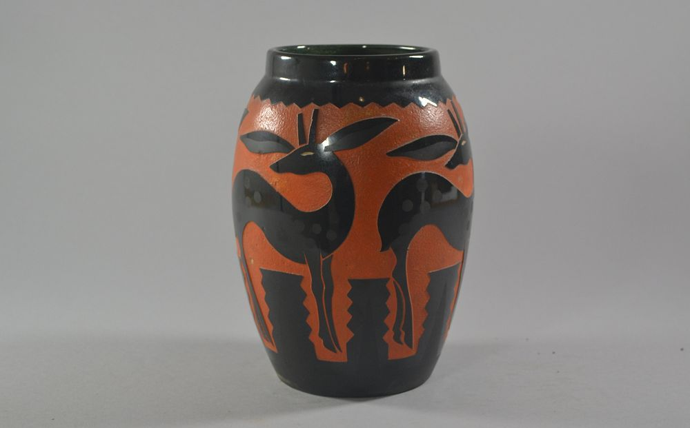 R. Mequinion black and orange vase. Antelopes pattern