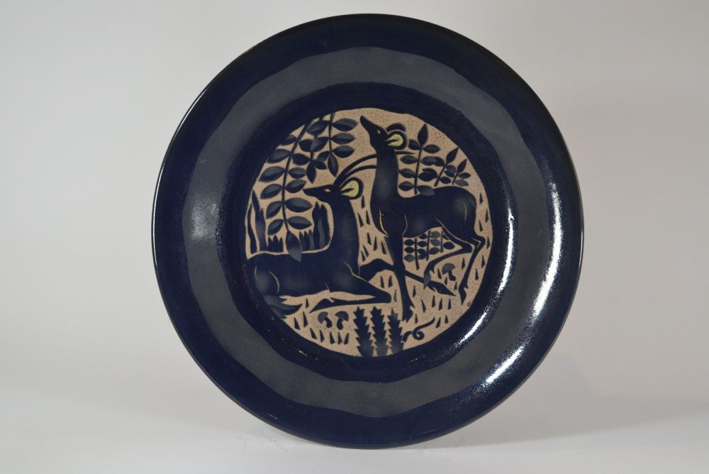 Roger Mequinion. Large Blue dish. Antelops couple pattern