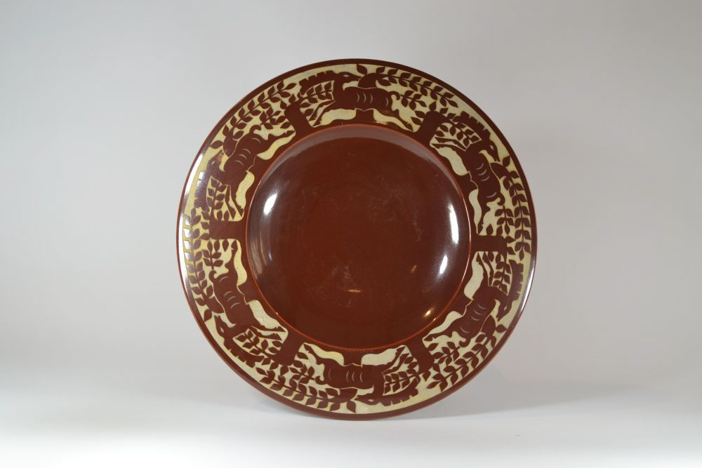 Roger Mequinion. Large brown dish. Deers pattern