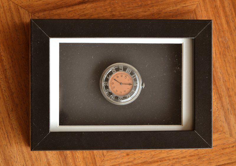 Framed skeleton art deco watch