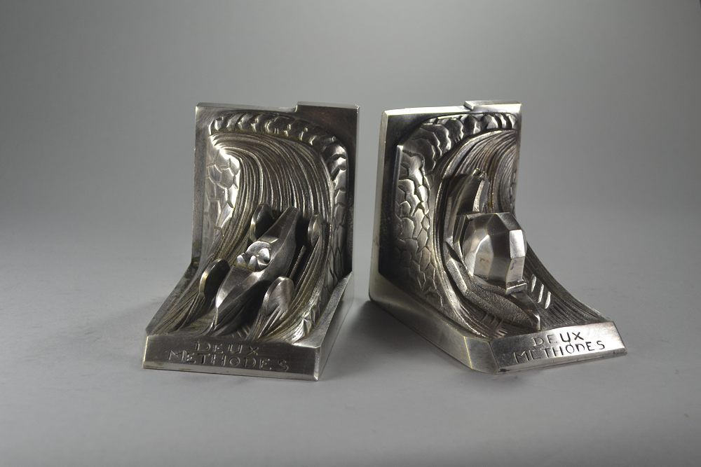 Race car against snail. Silver plated bookends.