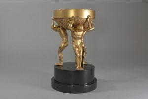 Art deco bronze cup centerpiece with three men