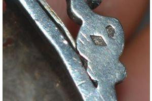 Art deco sterling silver brooch. Mask.