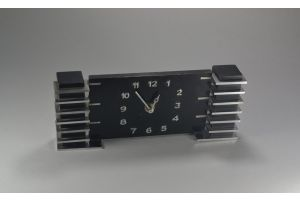 Rare Modernist art deco clock. Wood and nickel plated brass