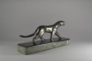 Michel Decoux. An art deco bronze panther on marble base