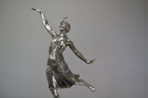 Joe Descomps tall bronze dancer with headdress