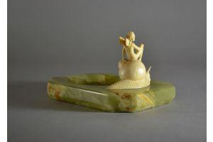 'Fairy riding a snail'. Art Deco ivory group, c. 1920.