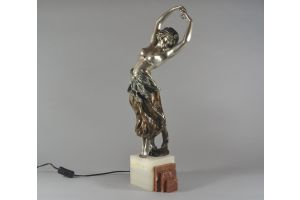 A. Gory bronze dancer with dinanderie patina. Lighted marble base.