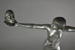 D. Grisard tall bronze figure of a masks dancer