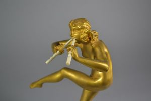 Rare Pierre Le Faguays gilded bronze sculpture. Dancer with pipes