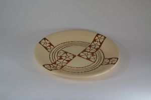 Roger Mequinion.Withe dish. Geometric flowers pattern