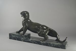 A. Ouline art deco bronze panther on marble base