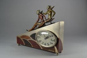 M. Offner. Art deco dinanderie clock with sledge