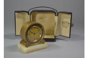 Art deco Zenith round clock in case. Enameled .